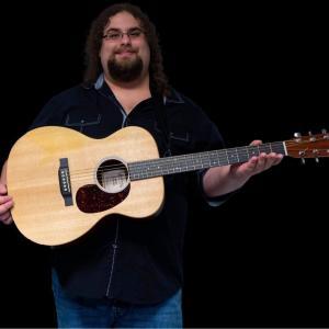 "Live Music Chris ""Caveman"" Jacquillard"